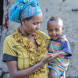 Mother holding son in Ethiopia