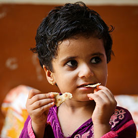 Little girl eating fortified bread