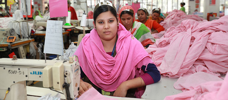 Garment worker with pink headscarf
