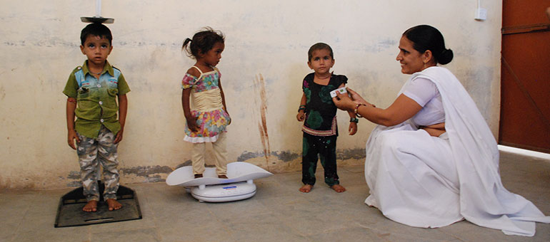 Kids being measured to assess progress in India