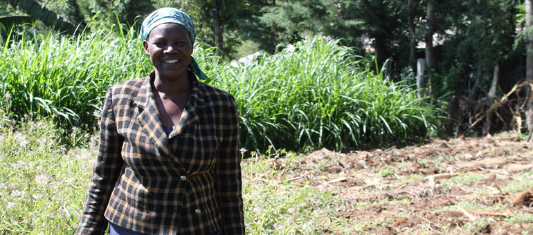 Tea worker standing in the field and smiling