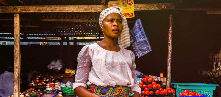 Woman selling tomatoes africa