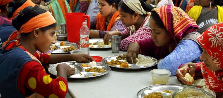 Women wearing colorful clothes eating together Bangladesh