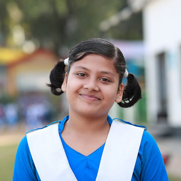 Adolescent girl with pigtails in Bangladesh