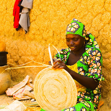 Woman making a basket in Geneva
