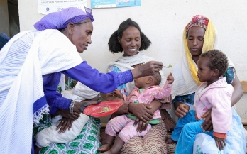 A health worker shows the proper way to feed the baby to mothers and children