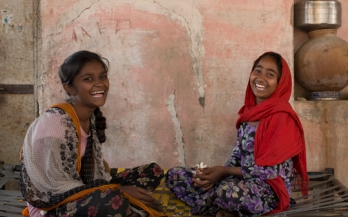 Girls smiling and playing in India