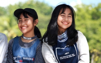 Two adolescents smiling in Indonesia