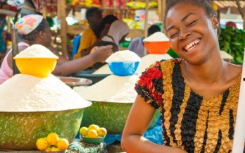 Young African Girl smiling in a market in Africa