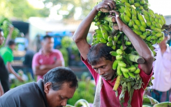 Man carrying bananas