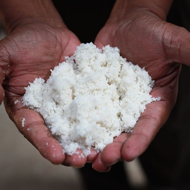 Hands holding and showing salt